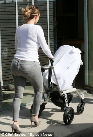 Busy Kim Kardashian in jeans