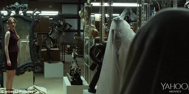 Chilling: In a series of fast-moving images that are certainly not for the faint-hearted, the Scottish actress is seen frozen in horror as she stands in a laboratory with three masked figures walking towards her