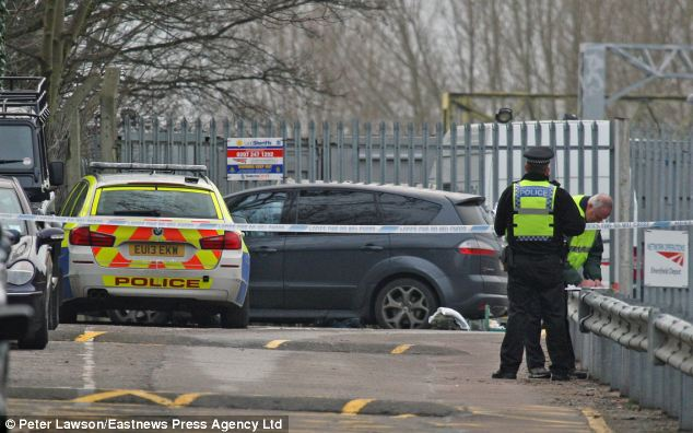 Dozens of armed officers from Essex Police were scrambled to the scene while a large section of the car park was taped off