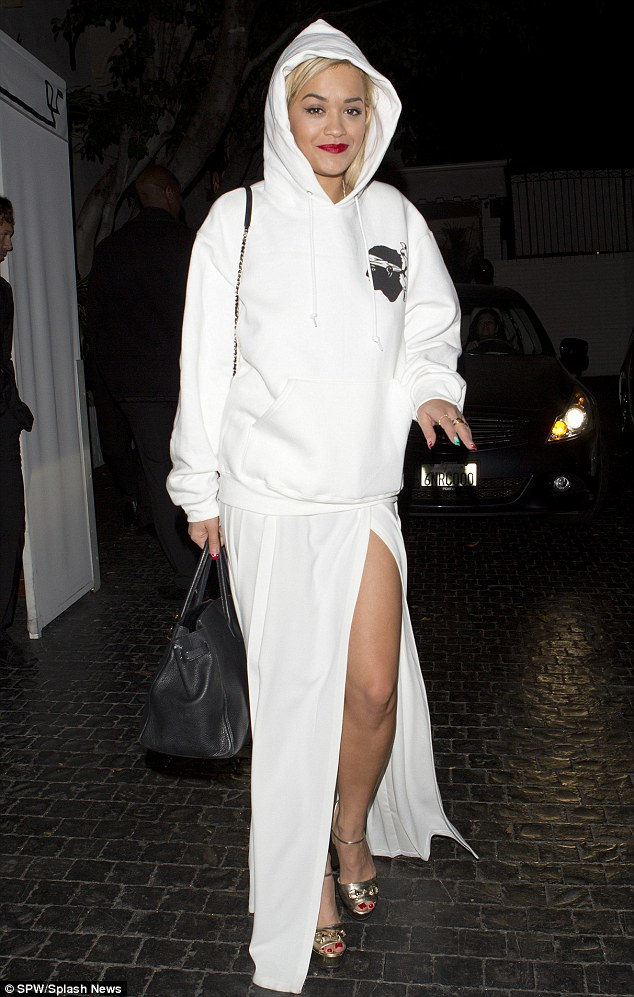 How We Do: Rita showcased her original style by wearing a hooded sweatshirt and long pleated skirt