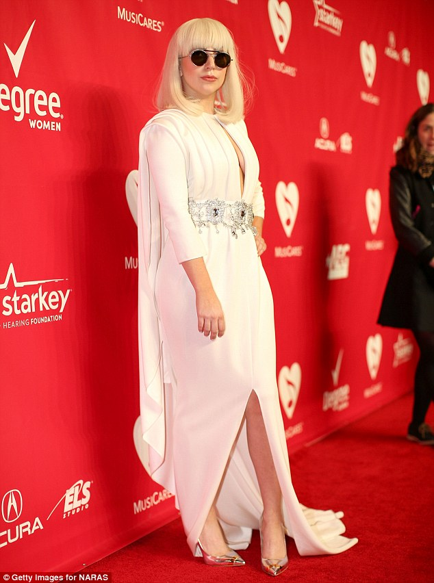 Smile girl: Lady Gaga has a tendency to not smile for photos and instead prefers to employ an enigmatic blank stare