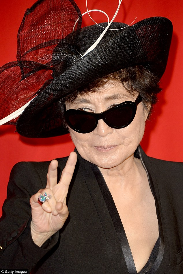 Peace out: The infamous music and art guru dressed in a similarly tailored black ensemble on the night