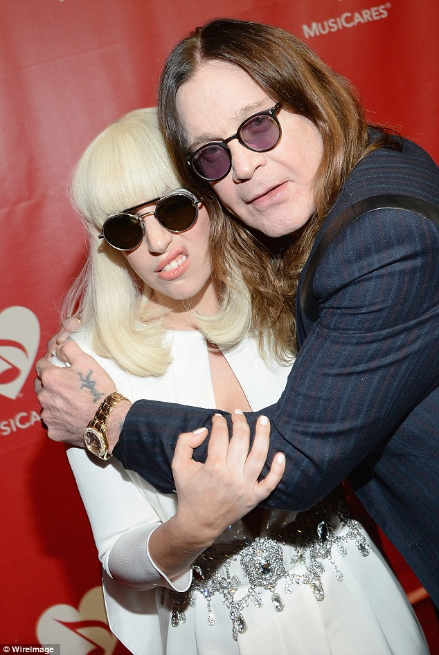 An enjoyable hug: Lady Gaga looked a little squished by the old timer