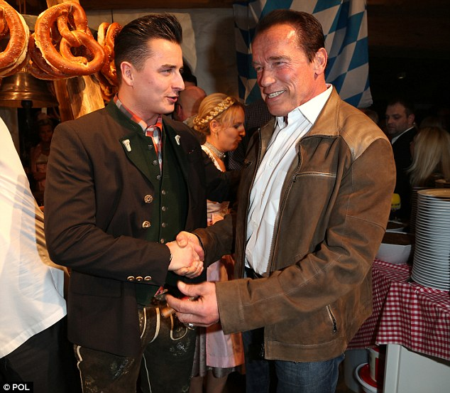 Nice to meet you: The Terminator star shakes hands with famous Austrian folk singer Andreas Gabalier at the Sausage Party