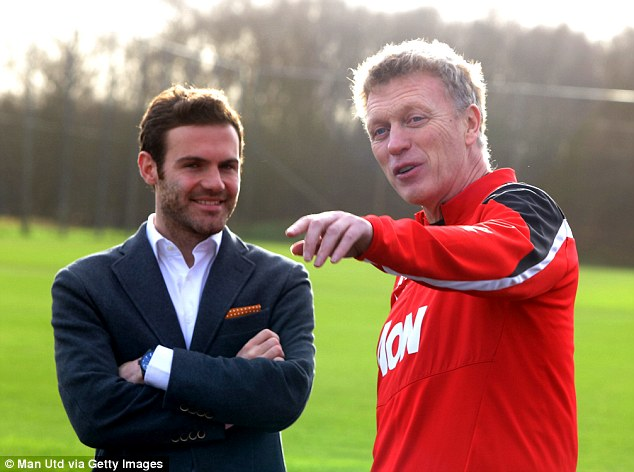 The grand tour: Mata and Moyes had a chat after the playmaker disembarked his helicopter