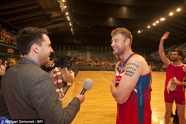 All smiles: Andrew Flintoff has a laugh after the match as a scantily clad Jack Whitehall waves to the crowd