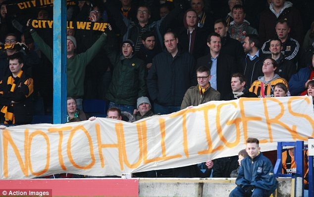 Upset: Hull City fans protest about the proposed name change for Premier League club