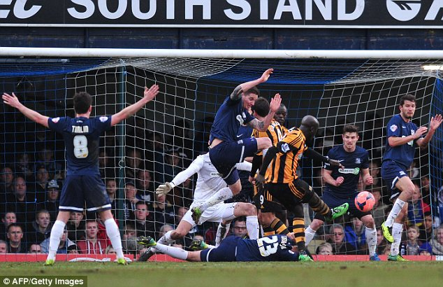Scramble: Hull City striker Yannick Sagbo (C) can't find a way past defenders