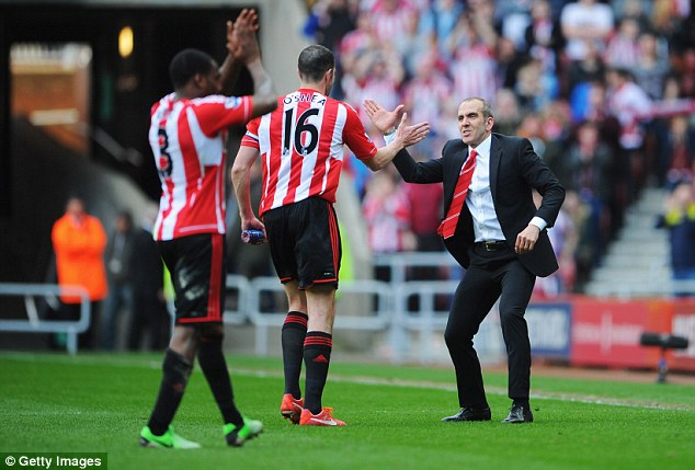 Put it there! Di Canio slaps hands with John O'Shea during the home game against Everton last season