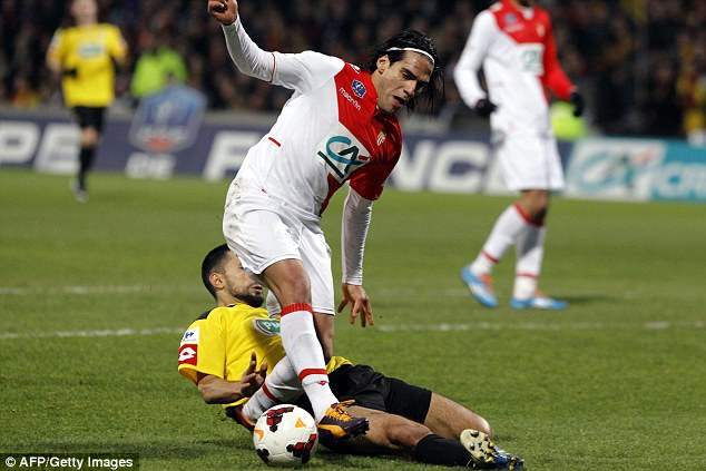 Ouch: Soner Ertek landed on top of Falcao's left knee, causing the player to be carried off the pitch