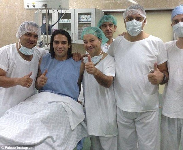 Happy: Colombia stiker Radamel Falcao sits up before surgery with the medical staff in Porto