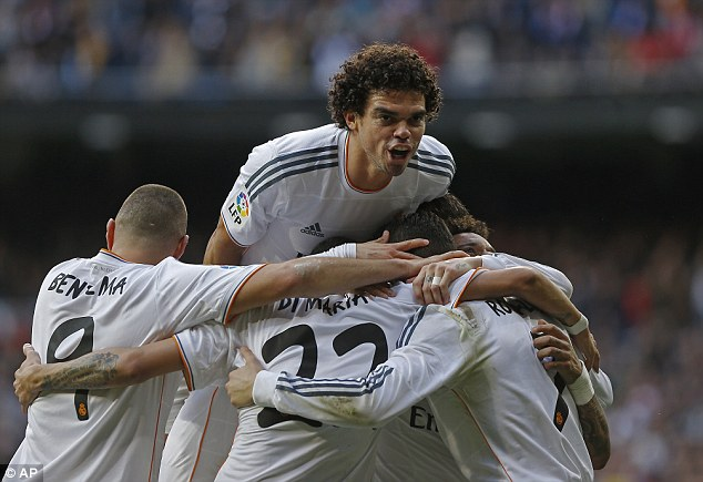 It's been a while: Madrid players, including Pepe (C), celebrate the win that takes them top of La Liga for the first time in 20 months