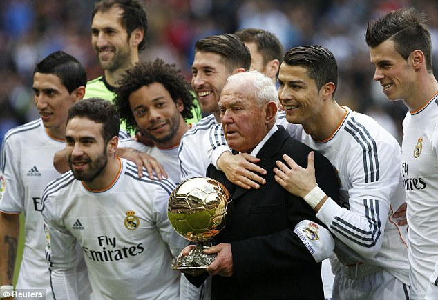 There's no I in team: Ronaldo poses for a team photo with Real Madrid teammates and field delegate Agustin Herrerin (C)