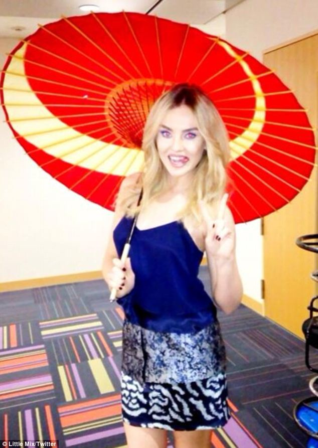 Eastern promise: Perrie Edwards looks polished and grown up as she poses with an umbrella in Japan