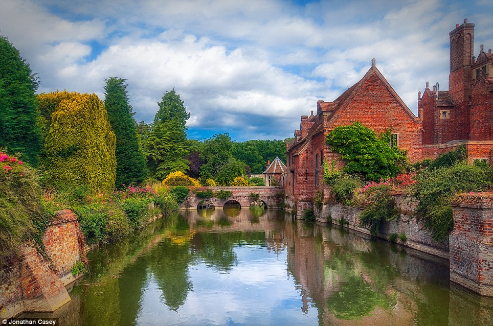 Sleek: This luscious shot of the gleaming moat at Kentwell Hall won the Gardens category. The hidden details of its spiraling garden peak invitingly over the Tudor structure
