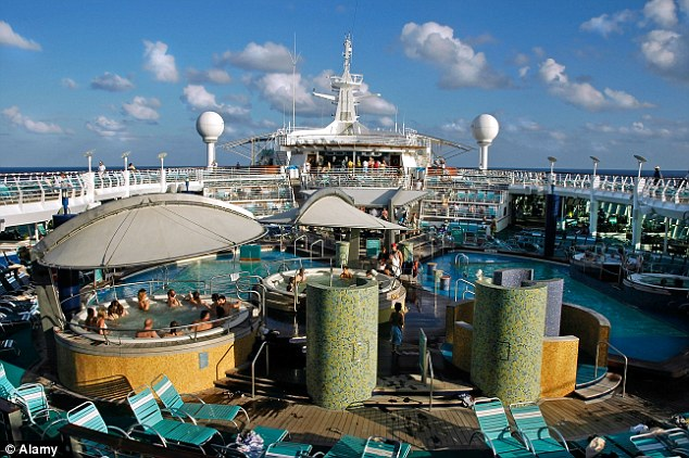 Making history: The incident was one the largest norovirus outbreaks on a cruise ship in the past 20 years. Above, The Explorer of Sea's deck, featuring an array of sunbeds, swimming pools and a jacuzzi