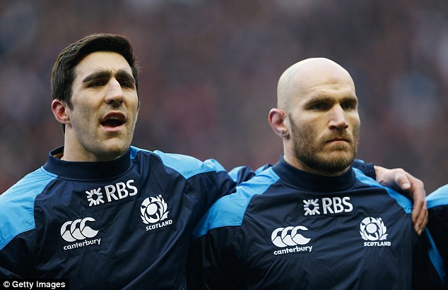 Oh Flower of Scotland: Kelly Brown (left) and Alasdair Strokosch (right) stand for the national anthem