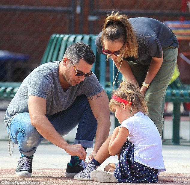 Daddy's little girl: Cash stopped to tie Honor's sneaker