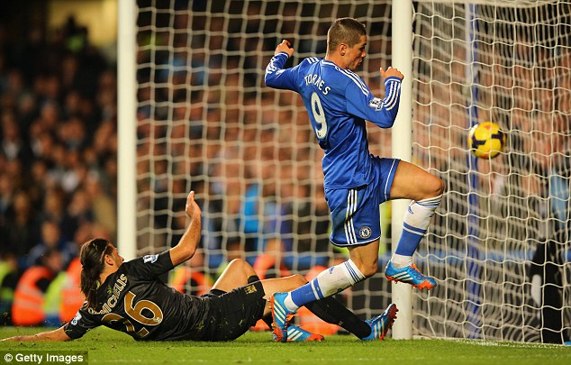 Rivalry: Fernando Torres' late goal gave Chelsea a 2-1 win against City in the Premier League this season
