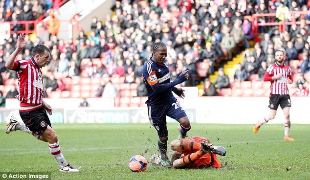 Wrong: Sheffield United goalkeeper George Long should have been sent off for this foul on Hugo Rodallega