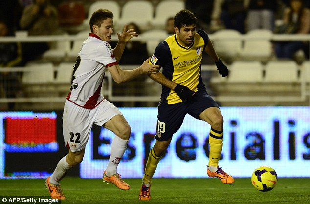 Out of position: Niguez (left) played in defence for Vallecano against parent club Atletico Madrid, and was looked at by Liverpool scouts on Sunday evening