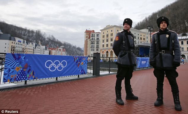 High alert: Russian Cossacks stand guard near the Rosa Khutor Alpine Resort in Krasnaya Polyana near Sochi. British intelligence chiefs say the 37,000 extra soldiers and police that have been drafted in to boost security have formed a 'ring of steel' around the event