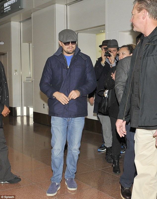 Warm welcome: Leonardo DiCaprio lands in Tokyo ahead of The Wolf Of Wall Street premiere in Japan