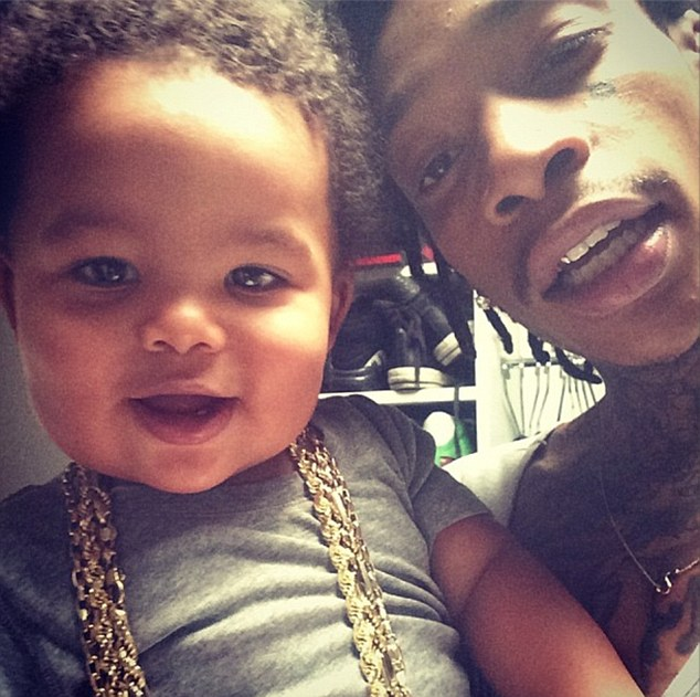 Nearly one year old! Amber Rose uploaded this picture of Wiz Khalifa and the couple's son Sebastian during the week with the cute tot wearing the musician's bling