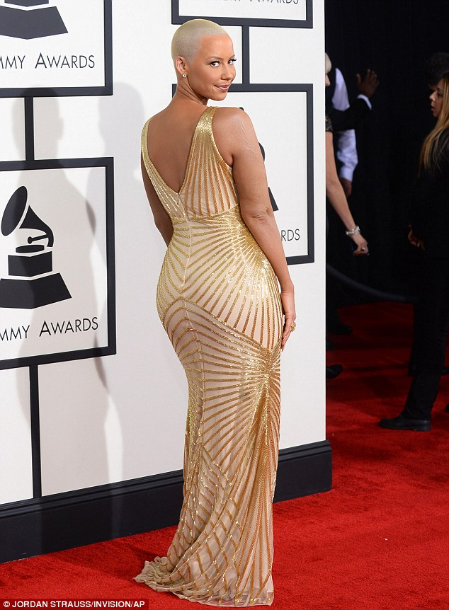 From all angles: The model and socialite looked stunning in the shimmering gold gown