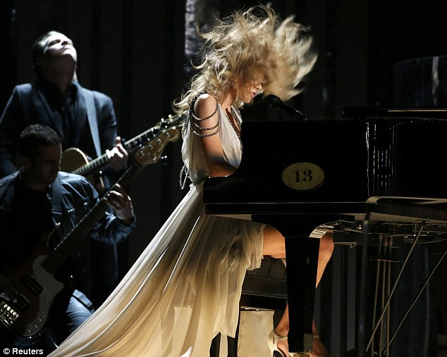 Hairography: Taylor really let loose once on stage as she engaged in some headbanging at her piano