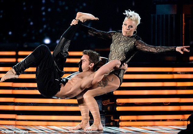 Trying her hardest: Pink put on an energetic performance of her hit single Try as she held a male dancer in a ballet move