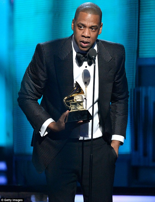 Here's looking at Blue: Jay Z dedicated his award to his baby daughter as he said he's got a 'gold sippy cup' for the youngster