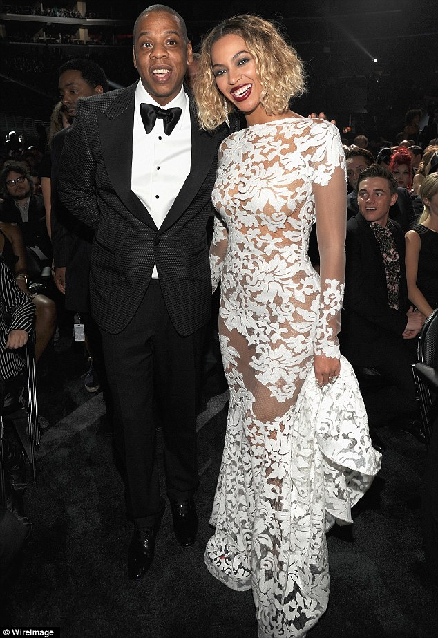 Holy matrimony: Jay and Beyonce pose after he wins a Grammy for his hit single Holy Grail