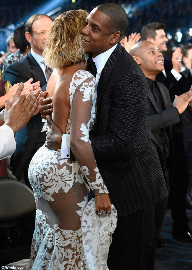 Celebrations: Jay hugs wife Beyonce before he takes to the stage to pick up his award