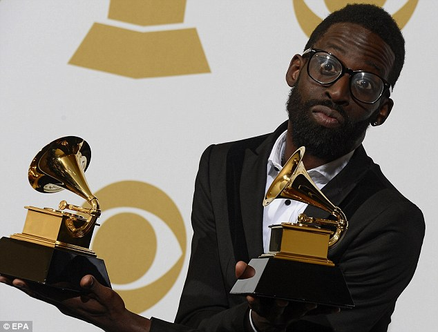 Double win: Singer Tye Tribbett holds the awards for Best Gospel Album and Best Gospel Song backstage at the Staples Center in Los Angeles