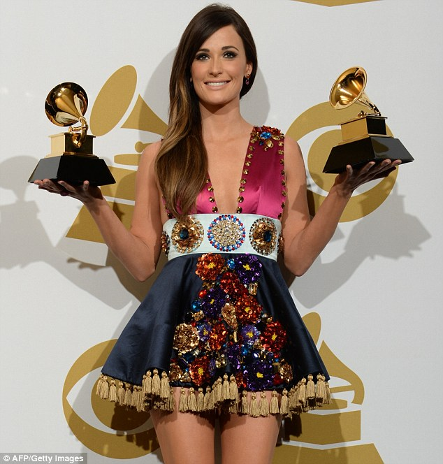 Take that Taylor: Kacey Musgraves poses two of her awards backstage at the Grammy Awards