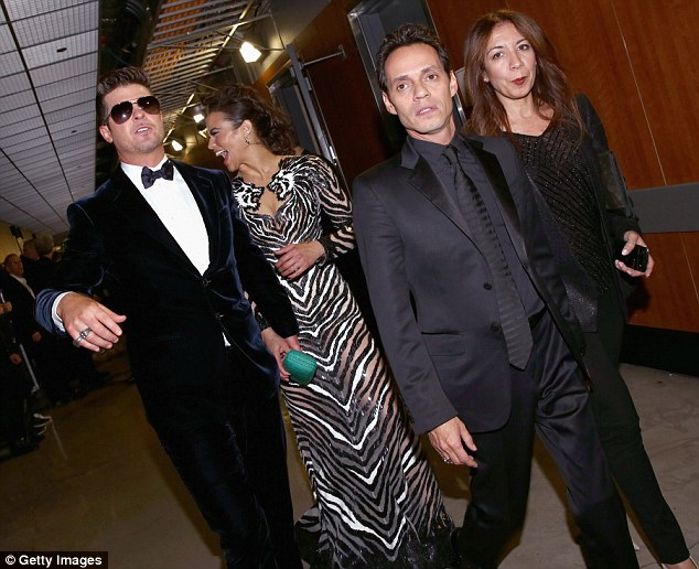 On the run: Robin Thicke, Paula Patton, Marc Anthony and a friend make a dash for the ceremony as they arrive