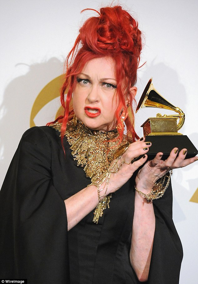 Anyone there? Singer Cyndi Lauper struck a stereotypically balmy backstage pose, and later tweeted her embarrassment after calling band Imagine Dragons... Magic Dragon