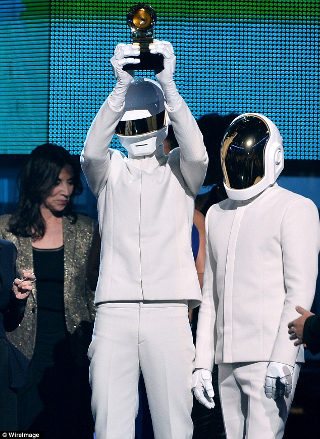 Getting lucky: Daft Punk accept the award for Album of the Year onstage during the 56th GRAMMY Awards at Staples Center on Sunday
