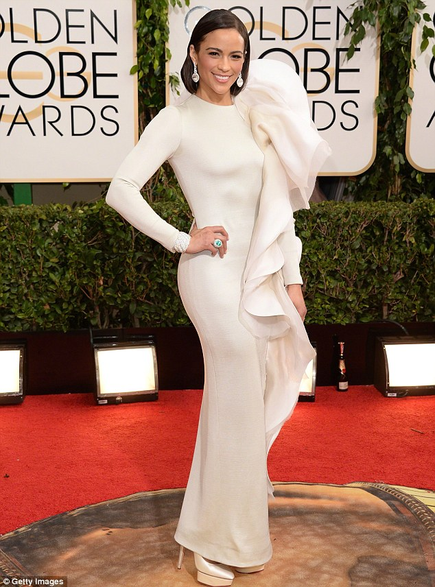Repeat offender: Just a few weeks ago Paula landed on the worst dressed list at the Golden Globes thanks to a skin tight white dress with a monstrous fabric ruffle that threatened to swallow her