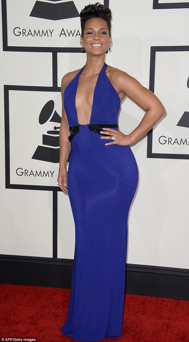 Dare to bare: A confident Alicia Keys poses in a plunging blue Armani Prive gown while walking the red carpet Sunday at the 56th Grammy awards in Los Angeles