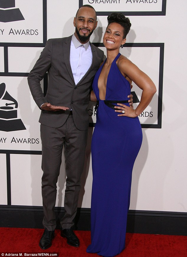 Showing off his lady: Music producer Swizz Beatz graciously allowed his wife Alicia to bask in the glow while walking the red carpet
