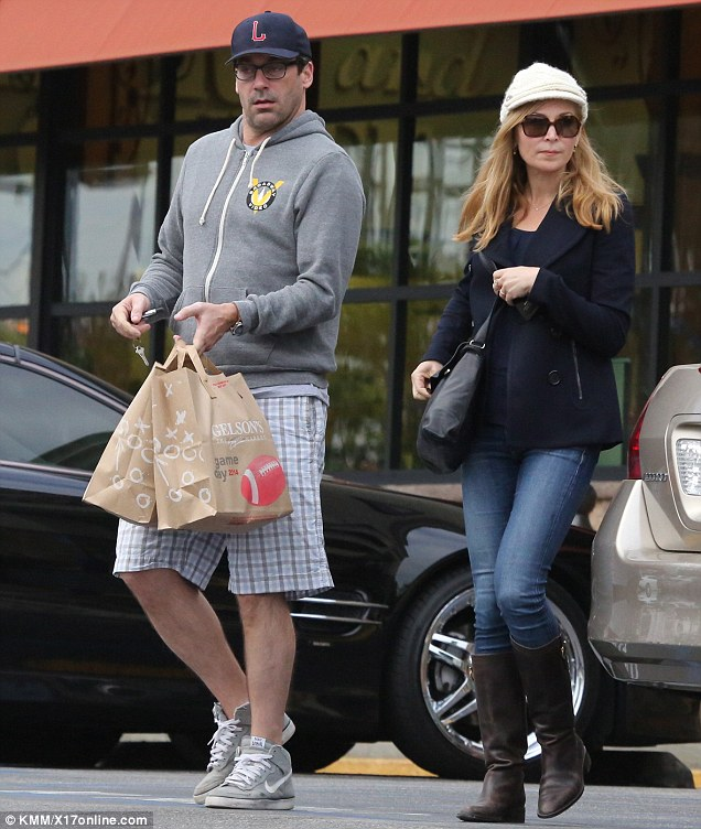 Casual outing: Jon dressed down in a grey hoodie and plaid shorts while Jennifer sported skinny jeans and boots