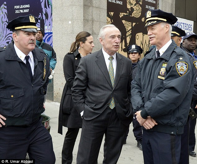 On the scene: Police Commissioner William Bratton (center) initially praised officers for their actions but has sine said he is awaiting the results of an Internal Affairs investigation