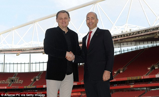 Sorted: Chief executive Ivan Gazidis (right) shakes on the deal with Puma's CEO Bjoern Gulden