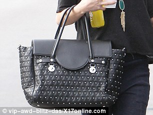 Pricy purse: Her black Versace bag sells for $3,295