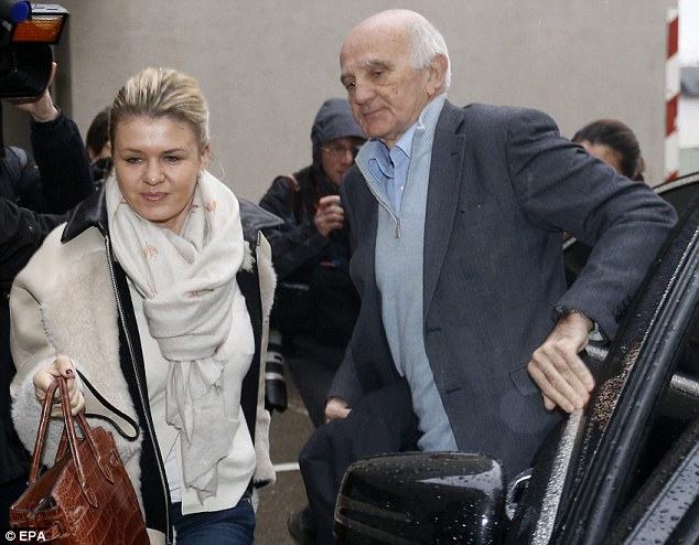Michael Schumacher's wife Corinna and French professor Gerard Saillant arrive at the hospital in Grenoble, France