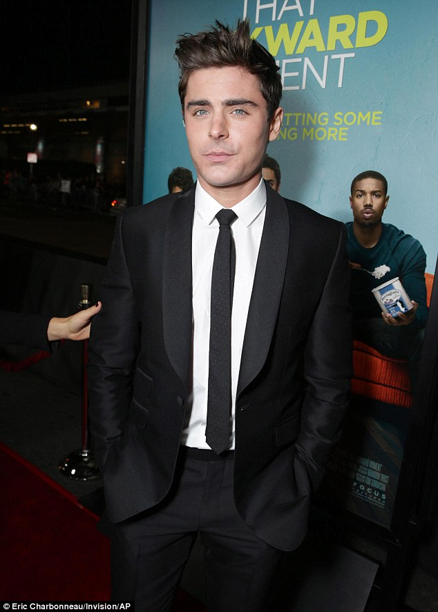 Not awkward at all: Zac looked sharp at the red carpet premiere