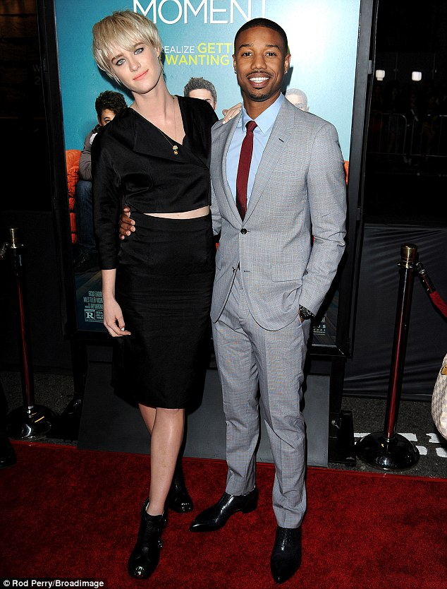 All wrapped up: Jordan and Mackenzie Davis held onto each other's hips for a portrait