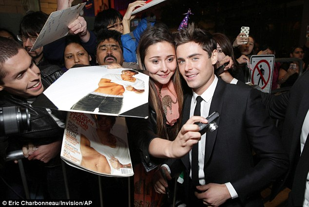 Fan selfie: The star posed for mementos with his adoring public